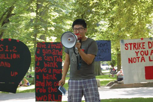 Daniel Hong, a rising political science major at Reed College, leads an assembly on student debt at Portland State University. (Olivia Olivia/the Portland Observer)